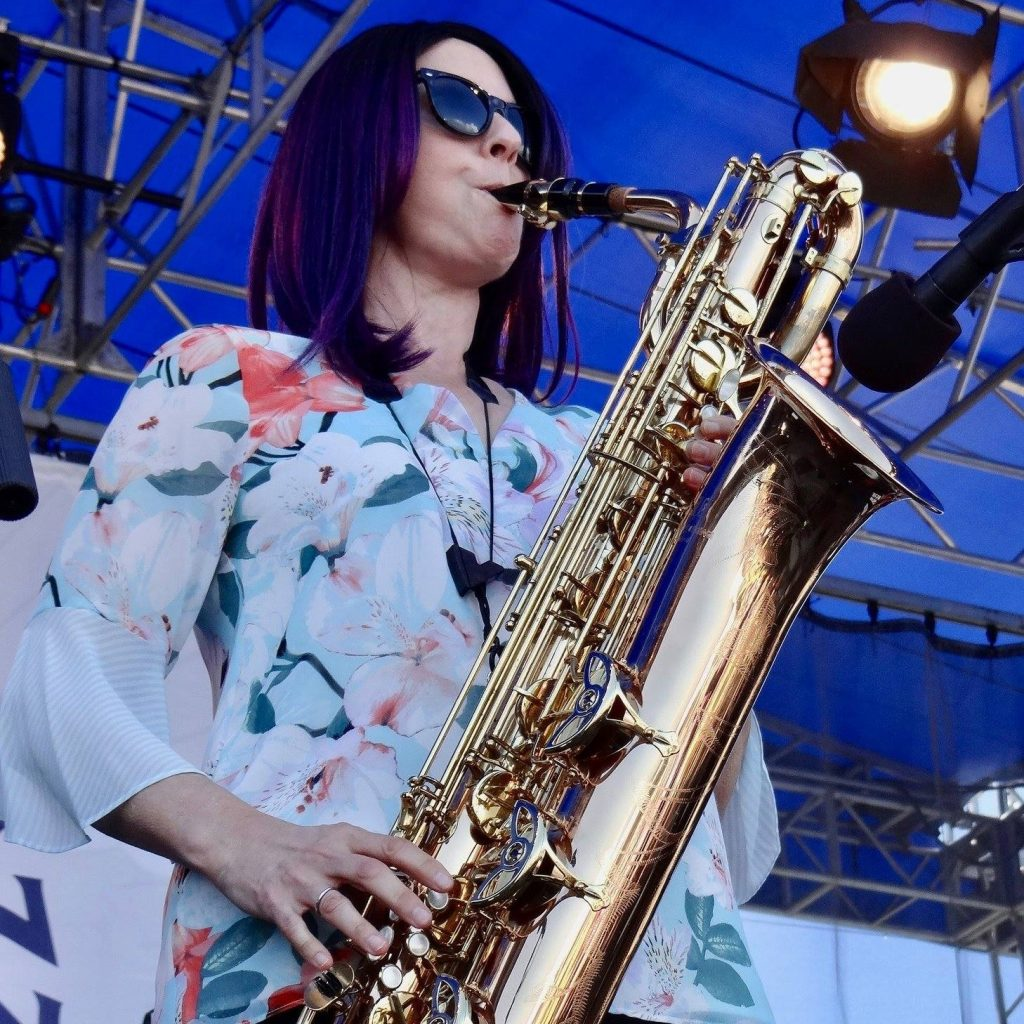 Leigh Pilzer playing baritone saxophone at the Newport Jazz Festival